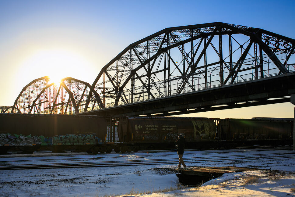 Manny, a PrairieView photography student, scooting onto the CP rail yards to get a photo. Day 39. (MELISSA TAIT / WINNIPEG FREE PRESS)