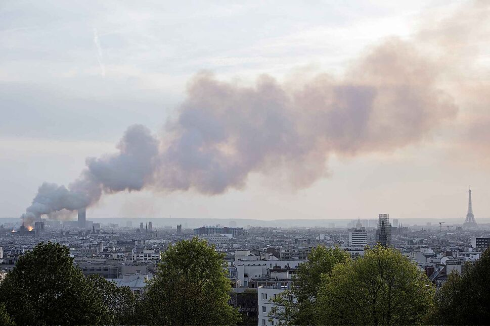 Smoke fills the air as Notre Dame cathedral burns. (Rafael Yaghobzadeh / The Associated Press)