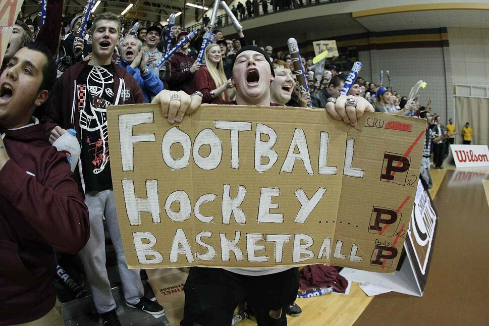 St. Paul's Crusader fans celebrate the school's first provincial AAAA basketball title in the same year the private boys' school captured provincial hockey and football championships. (JOHN WOODS / WINNIPEG FREE PRESS)