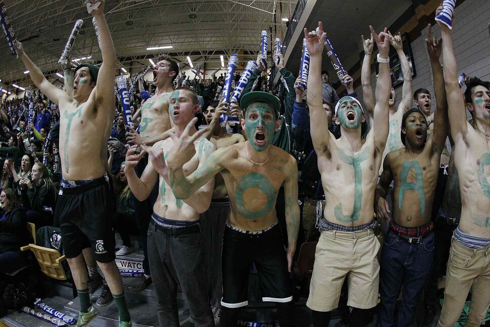 Vincent Massey Trojans fans celebrate after their team's victory in the girls' title game. (JOHN WOODS / WINNIPEG FREE PRESS)