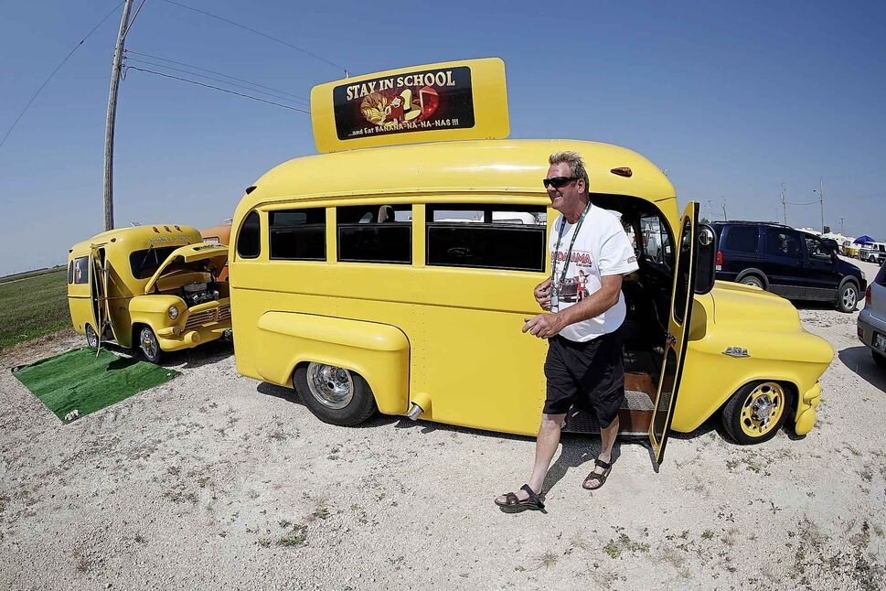 Ron Schellenberg with his yellow school bus themed trailer and 1957 school bus.