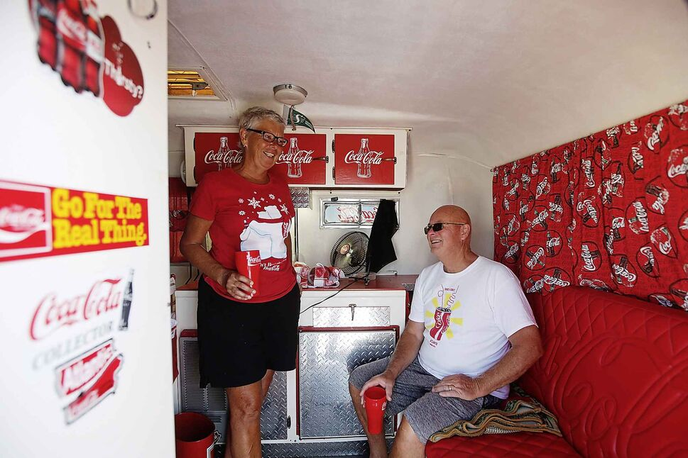 The Wiebes relax inside trailer.