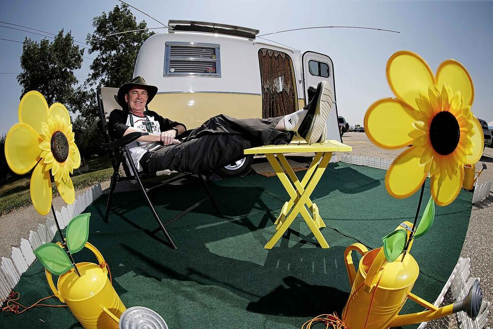 Ian Giles relaxes outside his trailer.