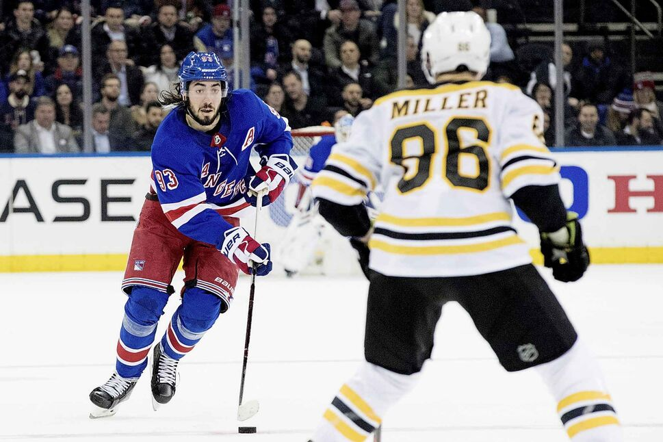 New York Rangers centre Mika Zibanejad (93) skates against Boston Bruins defenceman Kevan Miller (86). (MARY ALTAFFER)