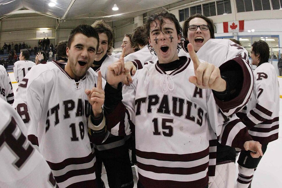 St. Paul's Crusaders players celebrate a championship. (JOHN WOODS / WINNIPEG FREE PRESS)