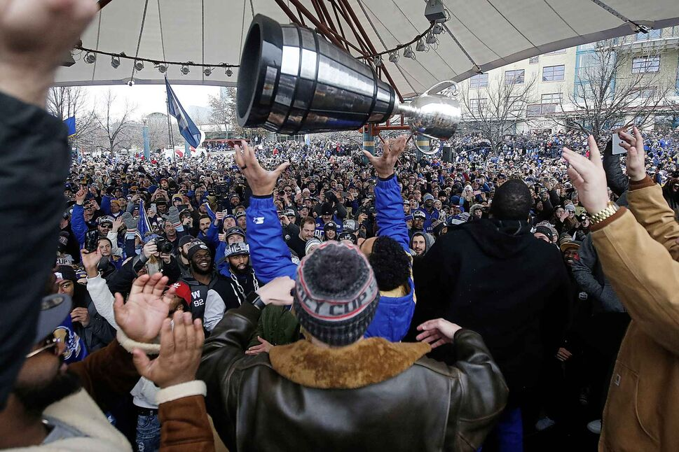 The cup is tossed in the air at The Forks. (John Woods / The Canadian Press)