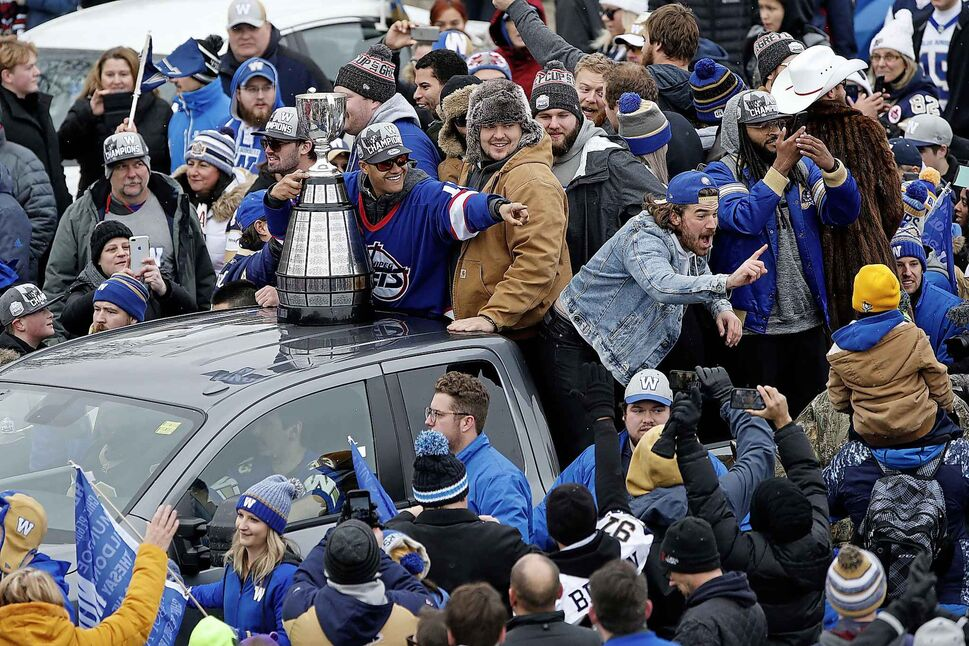 Winnipeggers are crowding the downtown streets Tuesday, Nov. 26, 2019, to celebrate with players the end of a Grey Cup drought that lasted almost three decades. The city is hosting a parade this afternoon after the Winnipeg Blue Bombers won their 11th Grey Cup with a 33-12 victory over the Hamilton Tiger-Cats on Sunday in Calgary. THE CANADIAN PRESS/John Woods (CP)