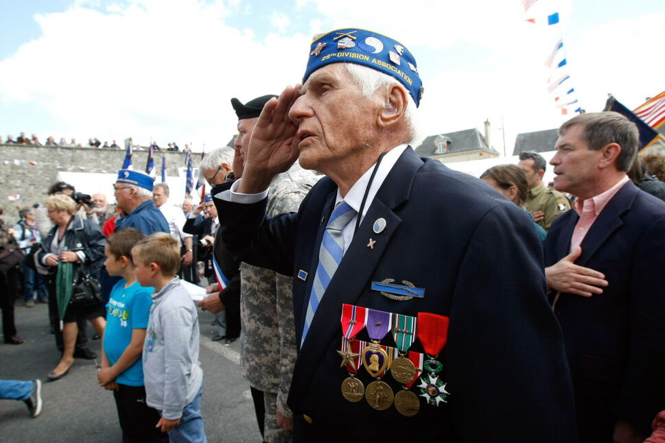 Ninety four year old U.S. WW II veteran Steve Melnikoff, from Cockeysville, Maryland, who landed at the Omaha Beach, on June 7, 1944 with the 29th Infantry Division, participates in a ceremony in honor of the division, in La Cambe, France, as part of the commemoration of the 70th D-Day anniversary on Wednesday.  (Claude Paris / The Associated Press )