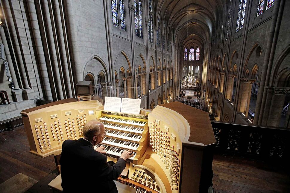 Philippe Lefebvre plays the organ at Notre Dame cathedral in Paris in 2013. (Christophe Ena / The Associated Press files)