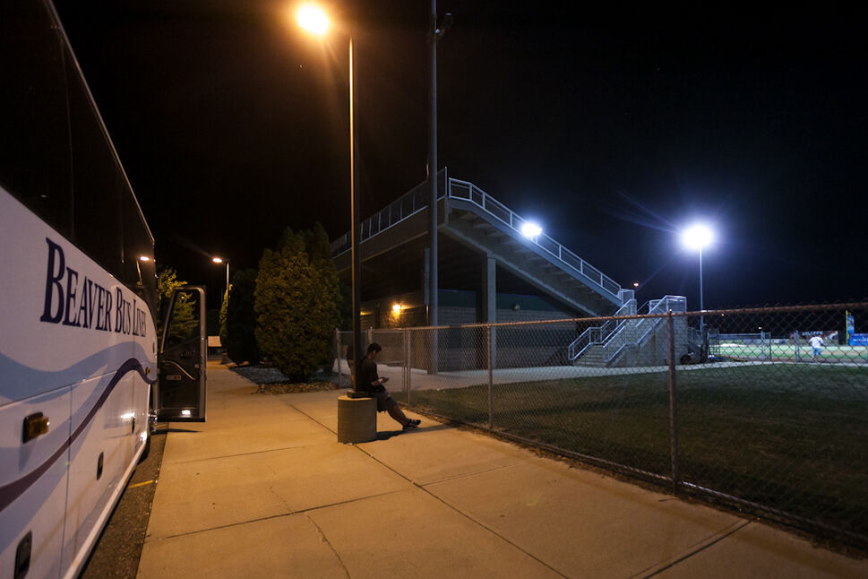 Pitcher Matt Rusch waits outside the team bus after a loss to Sioux City on Saturday night at Lewis and Clark stadium. (Melissa Tait / Winnipeg Free Press)