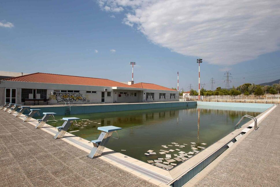 Murky water and rubbish fill an abandoned training pool for athletes at the Olympic village on the northern fringes of Athens. Some critics say that the multibillion dollar cost of the Greek games played a modest role in the nation's 2008 economic meltdown. (Thanassis Stavrakis / The Associated Press)