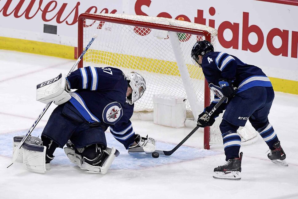 Winnipeg Jets' goaltender Connor Hellebuyck stopped 28 shots for his first shutout of the season. (CP)