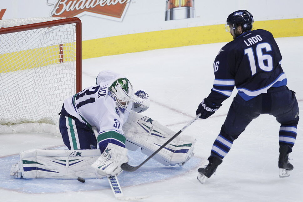 Vancouver Canucks goaltender Eddie Lack (31) saves the shot from Winnipeg Jets' Andrew Ladd (16) during the shootout. (JOHN WOODS / THE CANADIAN PRESS)