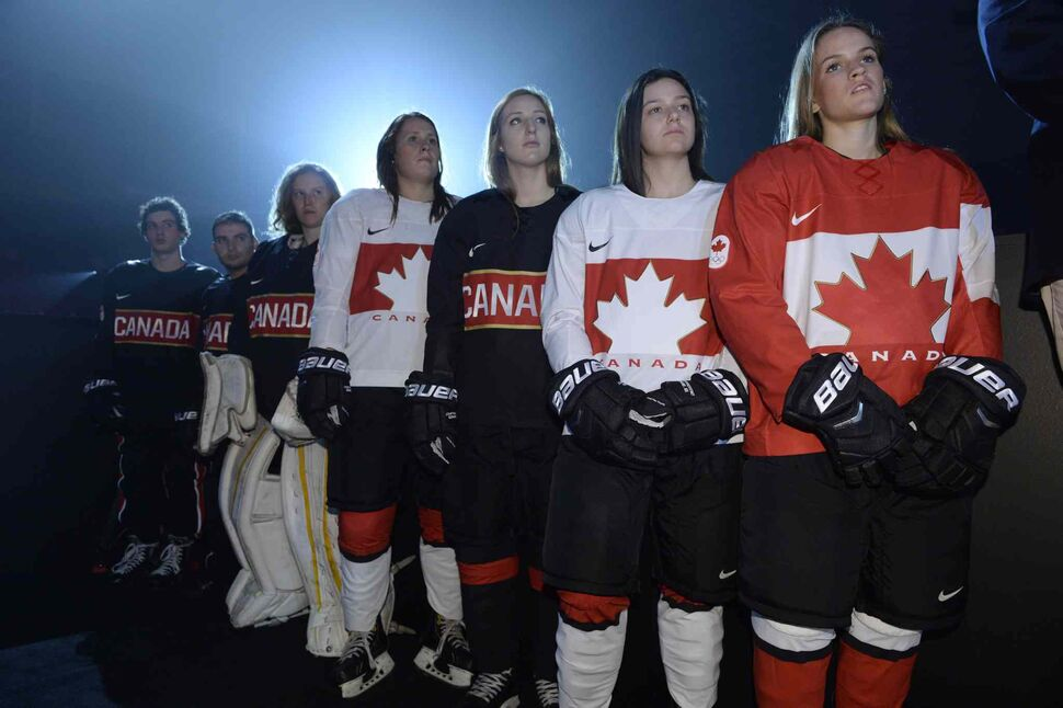 Youth players model the new Canadian Olympic team hockey jerseys as they are unveiled in Toronto on Tuesday. (Frank Gunn / The Canadian Press)