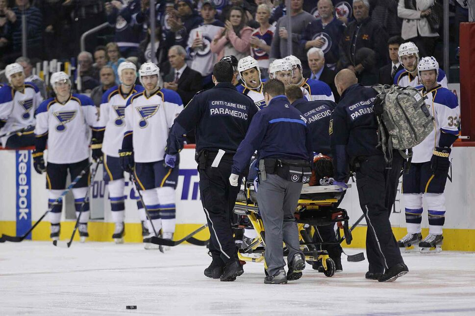 Jacob Trouba is taken off the ice by paramedics. (JOHN WOODS / THE CANADIAN PRESS)