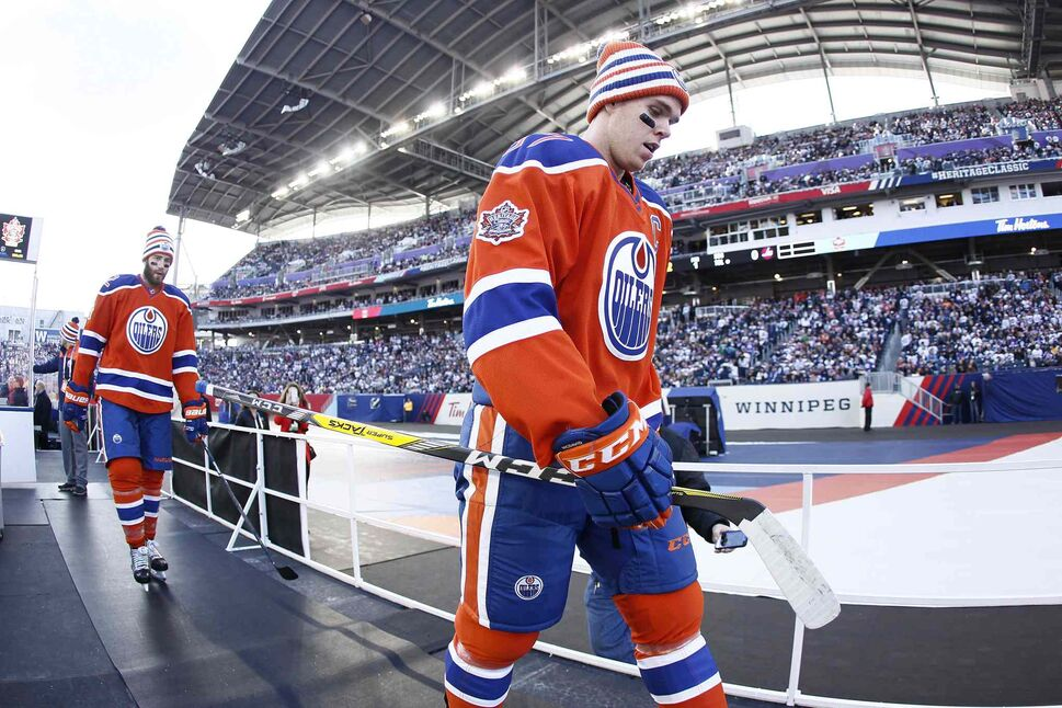 Edmonton Oilers' Connor McDavid (97) and Eric Gryba (62) leave the ice after the warmup skate at the NHL Heritage Classic in Winnipeg on Sunday. (JOHN WOODS / THE CANADIAN PRESS)