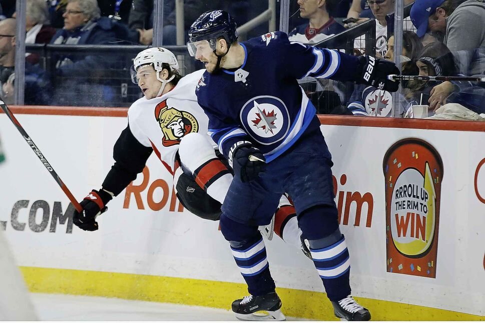 Career centreman Bryan Little is spending some time playing right wing. (John Woods / The Canadian Press)