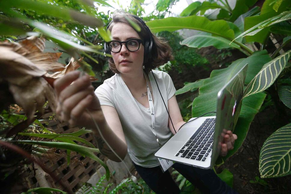 JOHN WOODS / WINNIPEG FREE PRESS</p><p>Helga Jakobson, Environmental Artist-in-residence at Assiniboine Park Conservatory, listens to and records conservatory plant electrical signals Sunday, March 25, 2018. Jakobson is recording plant signals and will convert them into instruments, and record a piece of music with the  Winnipeg Symphony Orchestra. The conservatory is closing within the month.</p>