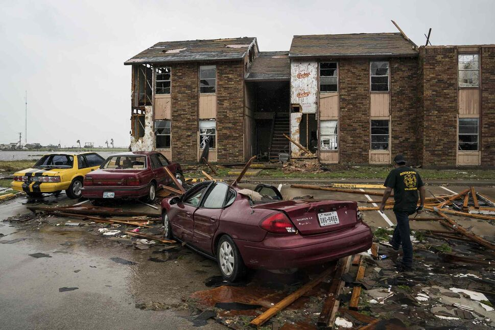 Firefighters search for survivors at an apartment complex in Rockport, Texas, as Hurricane Harvey hits the state's coast on Saturday.  (Jabin Botsford / The Washington Post)