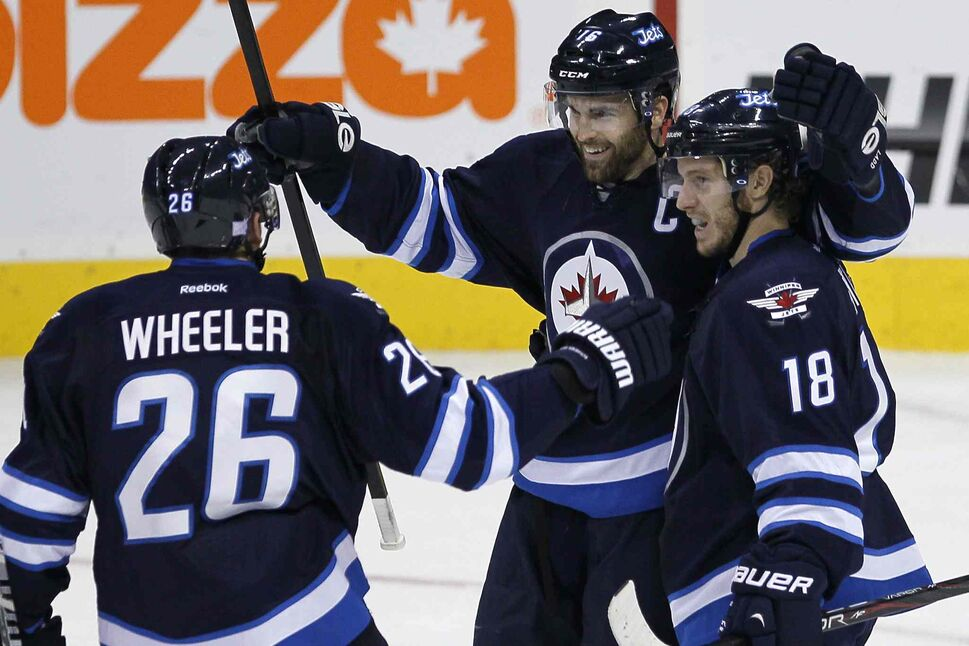 Winnipeg Jets' Blake Wheeler, Andrew Ladd and Bryan Little (18) celebrate Ladd's goal against the Anaheim Ducks during first-period NHL action at the MTS Centre in Winnipeg, Sunday.  (JOHN WOODS / WINNIPEG FREE PRESS)