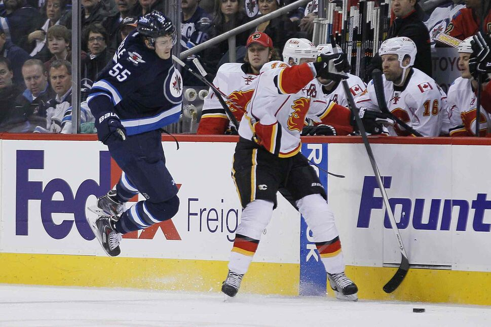 Winnipeg Jets' Mark Scheifele (55) collides with Calgary Flames' Matt Stajan (18) during second period NHL action in Winnipeg on Monday, November 18, 2013. (John Woods / Winnipeg Free Press)