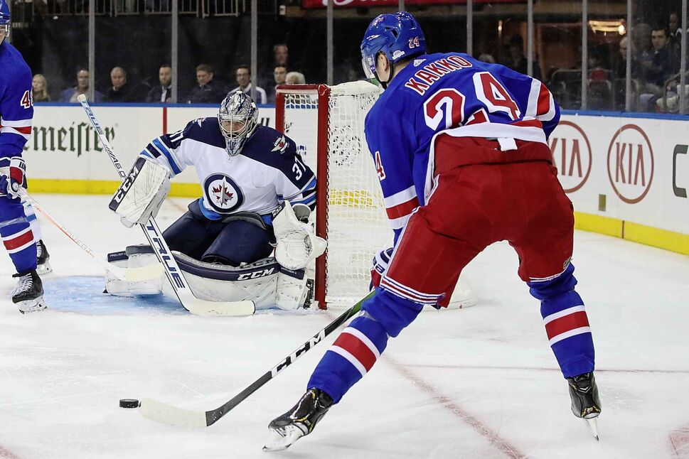 Connor Hellebuyck watches a shot by Kaapo Kakko. (Mary Altaffer / Associated Press files)