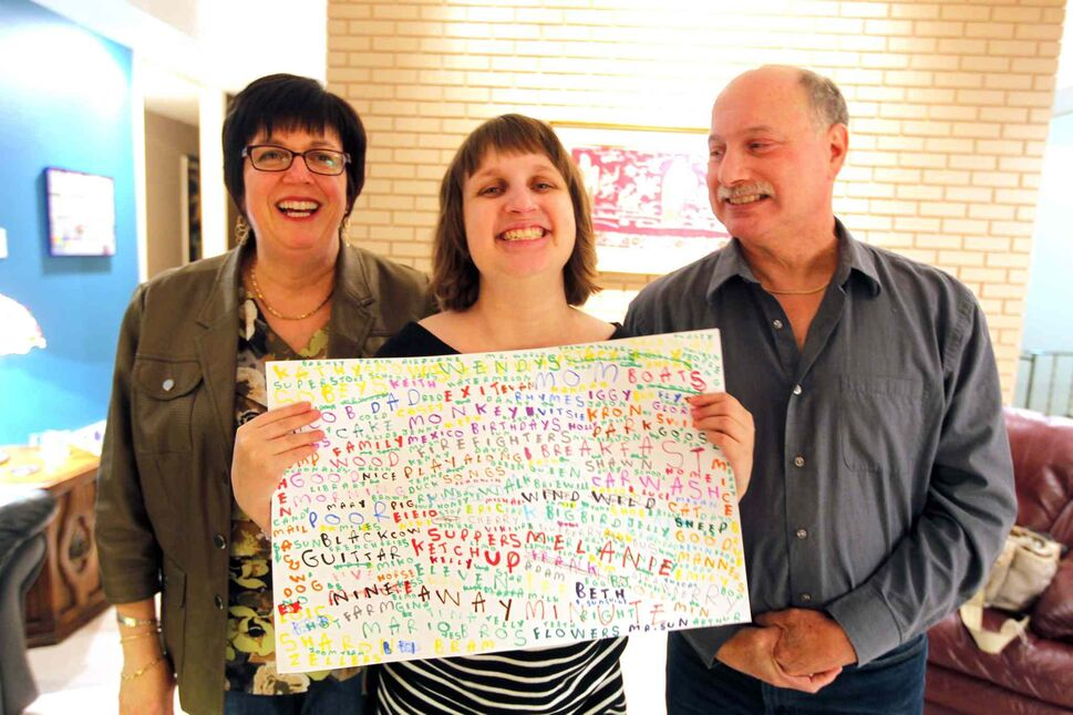 Melanie Halprin (centre), flanked by her parents, Brenda (left) and Phil, holds one of her creations. (Boris Minkevich / Winnipeg Free Press)