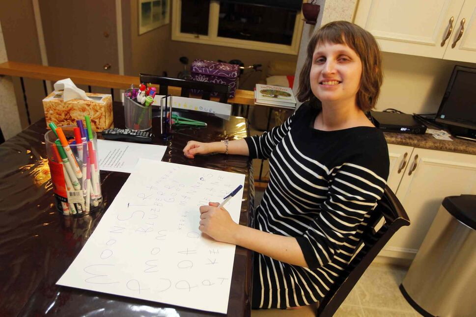 Melanie Halprin, 21, is autistic and is non-verbal. An artist in the Netherlands saw a card she designed and as a result, two pieces of her art were displayed in art show in Amsterdam where thousands of people saw it. (Boris Minkevich / Winnipeg Free Press)