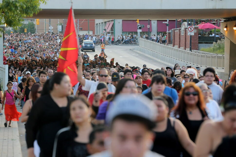 Thousands walk together from the Alexander Docks to the Oodena Circle at The Forks. (Trevor Hagan / The Canadian Press )