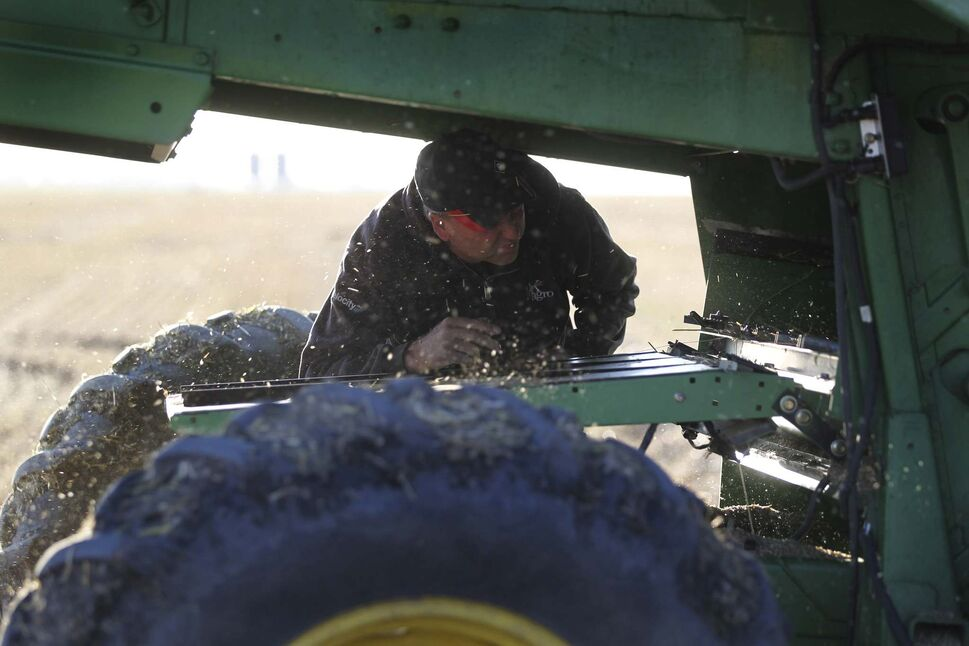 Anderson inspects the combine before Kara resumes operation.</p></p>