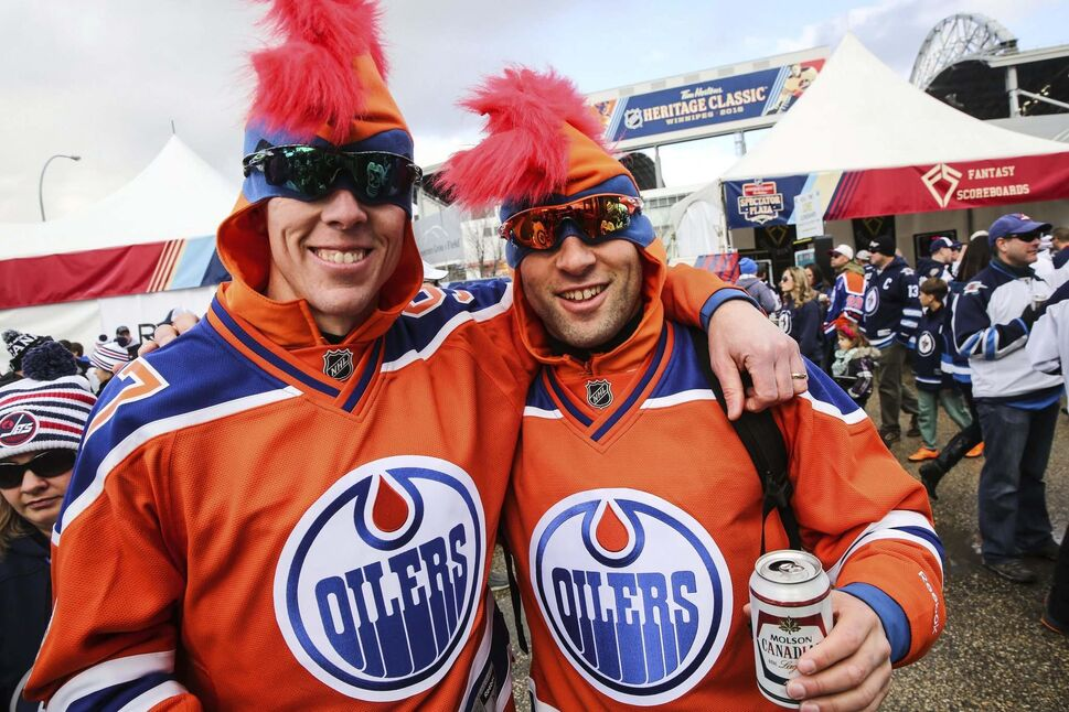 Conway Nelson (left) and Nathan Knezacek from Regina were among hundreds of fans gathered at the Spectator Plaza across the street from Investors Group Field on Sunday before the NHL game between the Winnipeg Jets and the Edmonton Oilers. (MIKE DEAL / WINNIPEG FREE PRESS)