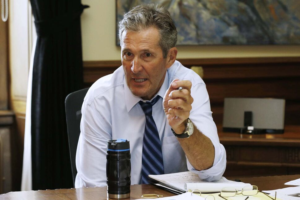 Manitoba Premier Brian Pallister said the government may be faced with a choice of imposing health-care premiums or reducing health-care services. (John Woods / Winnipeg Free Press files)