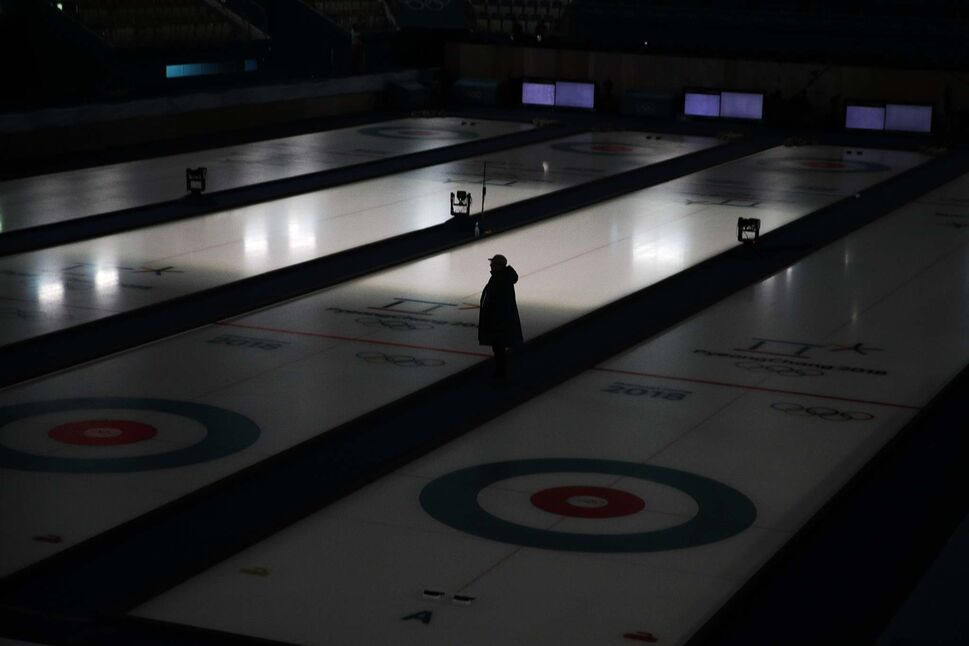 JAE C. HONG /THE ASSOCIATED PRESS</p><p>A technician stands between the ice sheets at the Gangneung Curling Center ahead of the 2018 Winter Olympics in Gangneung, South Korea, Tuesday, Feb. 6, 2018.</p>