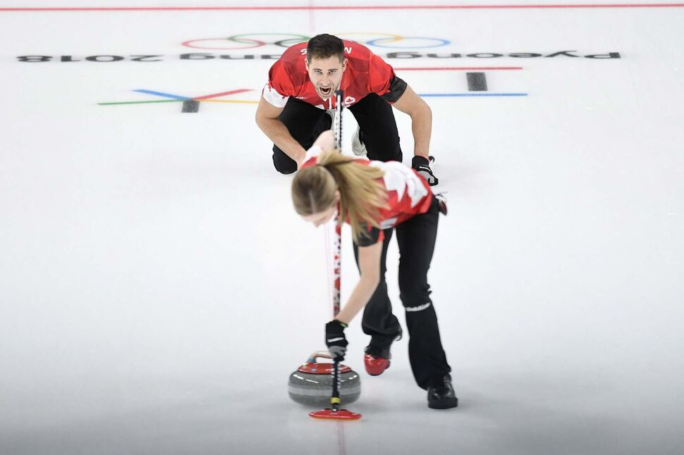 Canada's Kaitlyn Lawes and teammate John Morris play their stone during mixed doubles gold-medal curling action against Switzerland at the Olympic Winter Games in Gangneung, South Korea on Tuesday. (Nathan Denette / The Canadian Press)