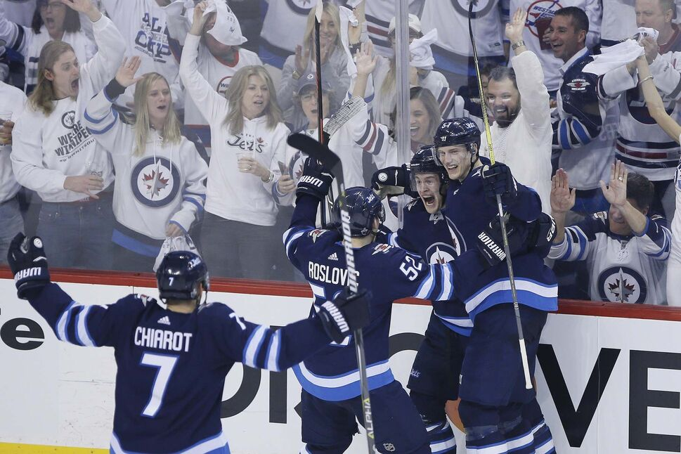 Winnipeg Jets celebrate Andrew Copp's goal against the Minnesota Wild during third period Friday.