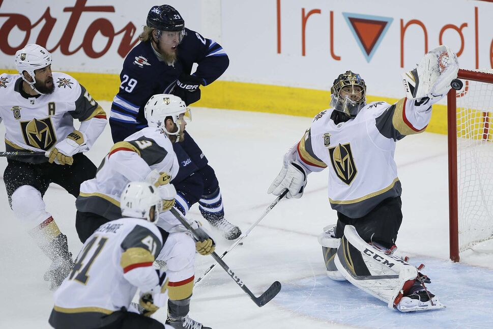 Vegas Golden Knights goaltender Marc-Andre Fleury stops a shot by Winnipeg Jets' Patrik Laine during first period in Winnipeg on Monday. (JOHN WOODS/ WINNIPEG FREE PRESS)