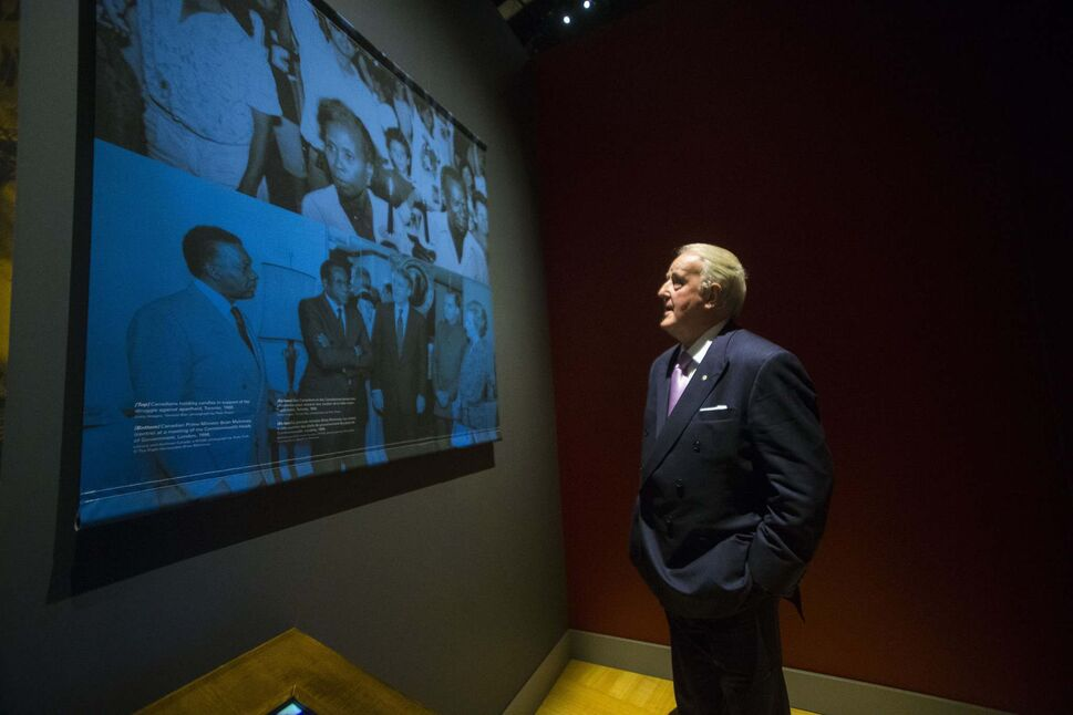 MIKAELA MACKENZIE / WINNIPEG FREE PRESS</p><p>Former Prime Minister Brian Mulroney takes a look at the Mandela exhibit (where pictures and excerpts from his own speech was used) after attending a gala celebrating the opening of the exhibition at the Canadian Museum for Human Rights in Winnipeg on Monday.</p>