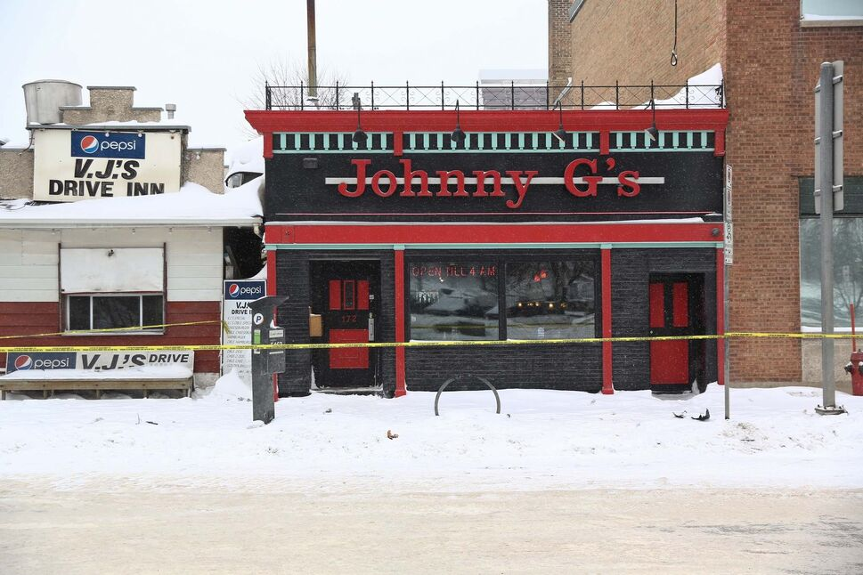 Late Thursday morning Winnipeg police were still at Johnny G's investigating the deaths of two men. (Mike Deal / Winnipeg Free Press)