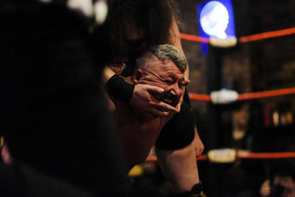 """Beautiful"" Bobby Jay is held in a headlock during a match.</p>"