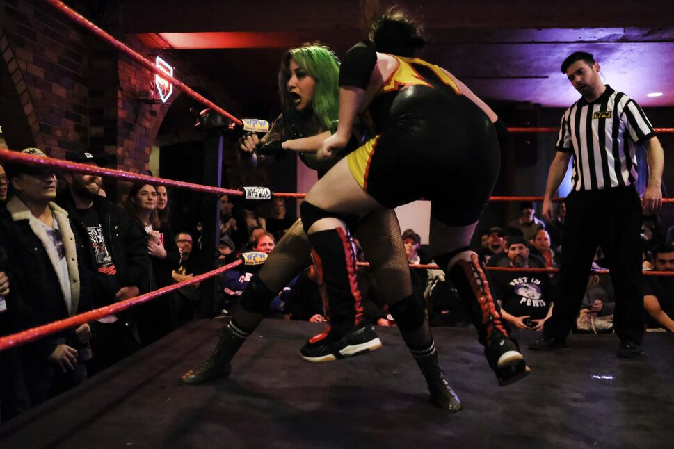 Shotzi Ryan delivers an elbow to her opponent.</p>