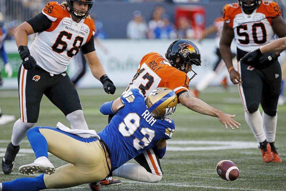 Winnipeg Blue Bombers' Craig Roh sacks B.C. Lions quarterback Mike Reilly and forces a fumble in Winnipeg Thursday.