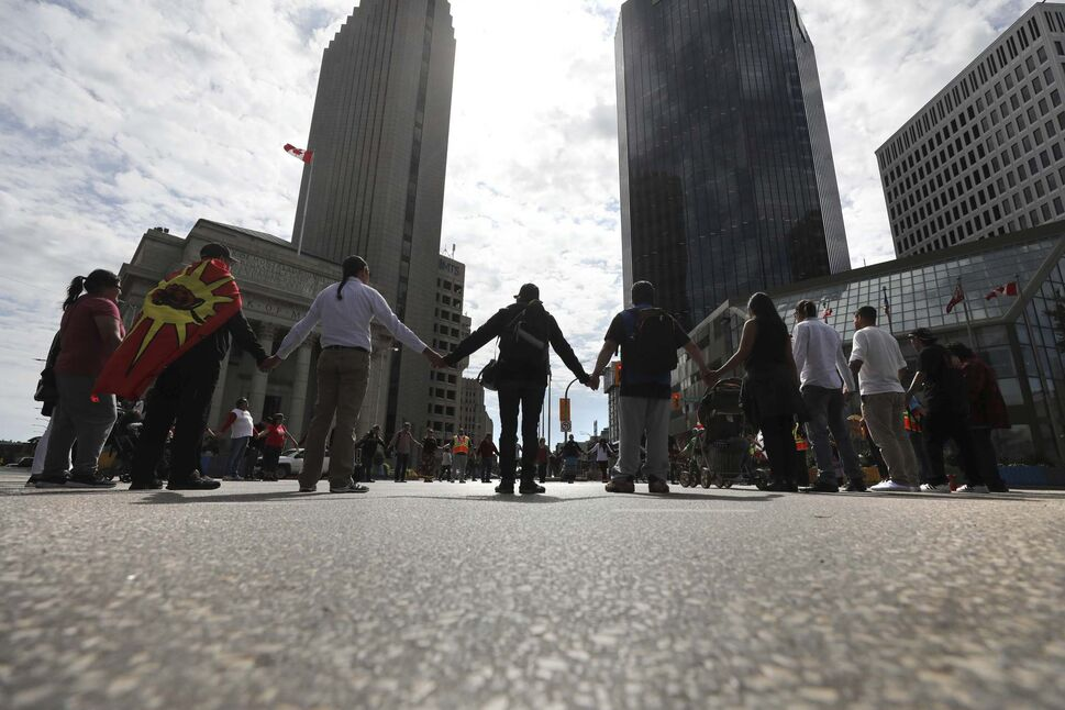 The dancers shut down Portage and Main during the noon hour last week. (Ruth Bonneville / Free Press files)