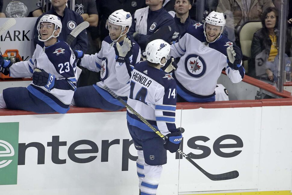 Winnipeg Jets' rookie defencman Ville Heinola celebrates after scoring his first career NHL goal against the Pittsburgh Penguins. (Gene J. Puskar / The Associated Press)