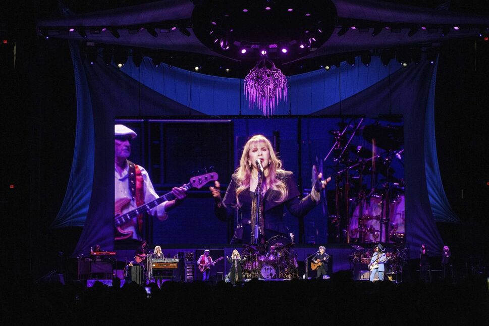 Stevie Nicks leads Fleetwood Mac through their set in their 50th Anniversary tour stop at Bell MTS Place Thursday. (Mike Sudoma / Winnipeg Free Press)