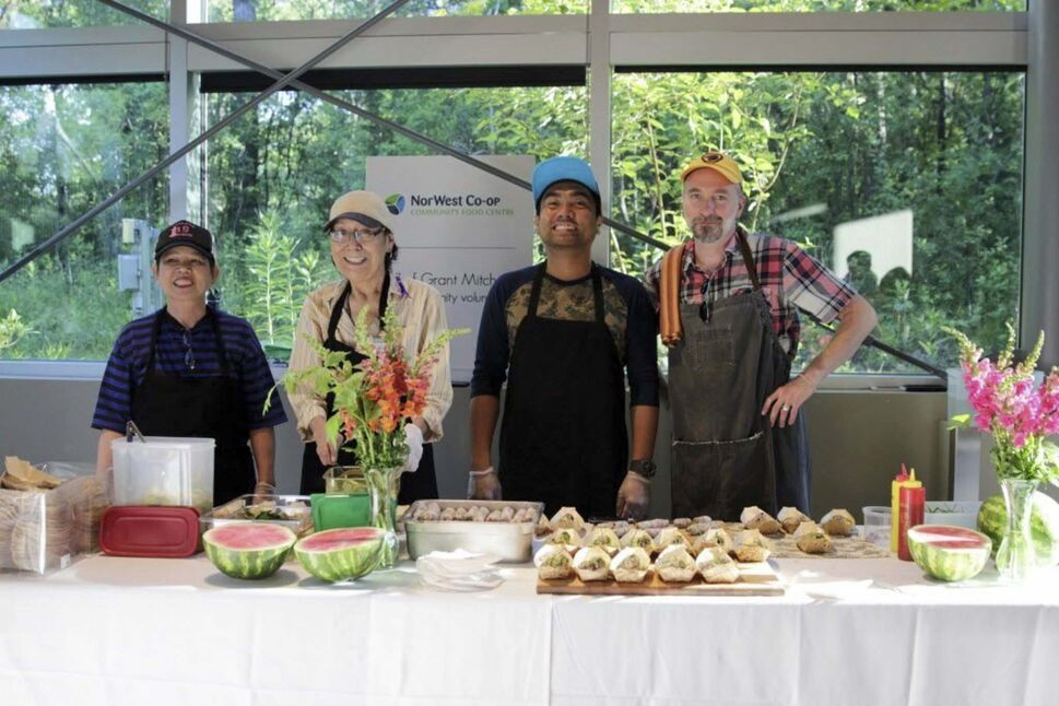 Community volunteers Somphone Wong, Sharon Czuba and Ryan Lao with community chef Grant Mitchell of the NorWest Co-op Community Food Centre.</p>