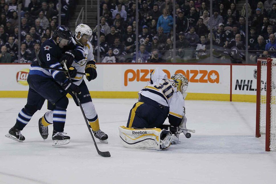 Nashville Predators' goaltender Carter Hutton's (30) save goes off of his own leg for the goal by Winnipeg Jets' Blake Wheeler's (26) as Jets' Jacob Trouba (8) and Preds' Seth Jones (3) look on during second period in Winnipeg Tuesday. (John Woods / Winnipeg Free Press)