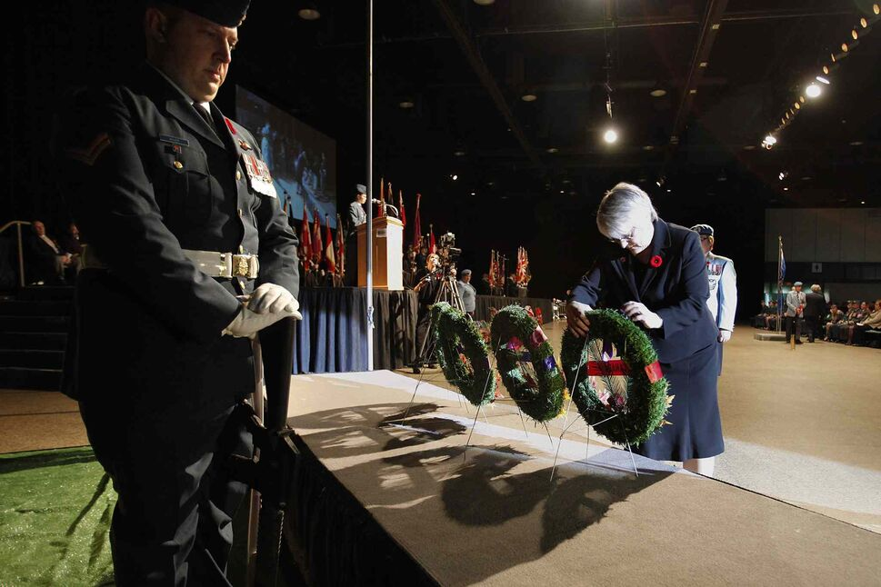 Sen. Jo-Anne Buth lays a wreath at the Remembrance Day service at the RBC Convention Centre Winnipeg. (JOHN WOODS / THE CANADIAN PRESS)
