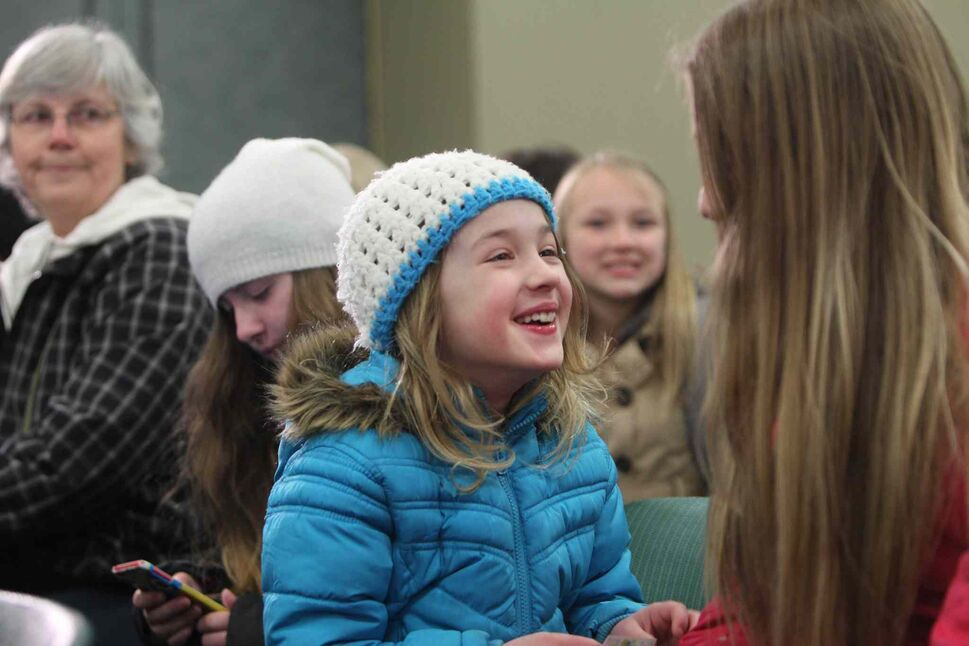 Eight-year-old Amira Smith is all smiles as she waits with her friend Mckenzie Smith, 11, to audition with hundreds of kids for the Next Star Saturday.