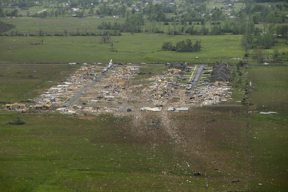 A debris trail, bottom, left when a tornado struck a Vilonia, Ark., neighborhood, leads from the rows of houses Monday, April 28, 2014. (Danny Johnston / The Associated Press)