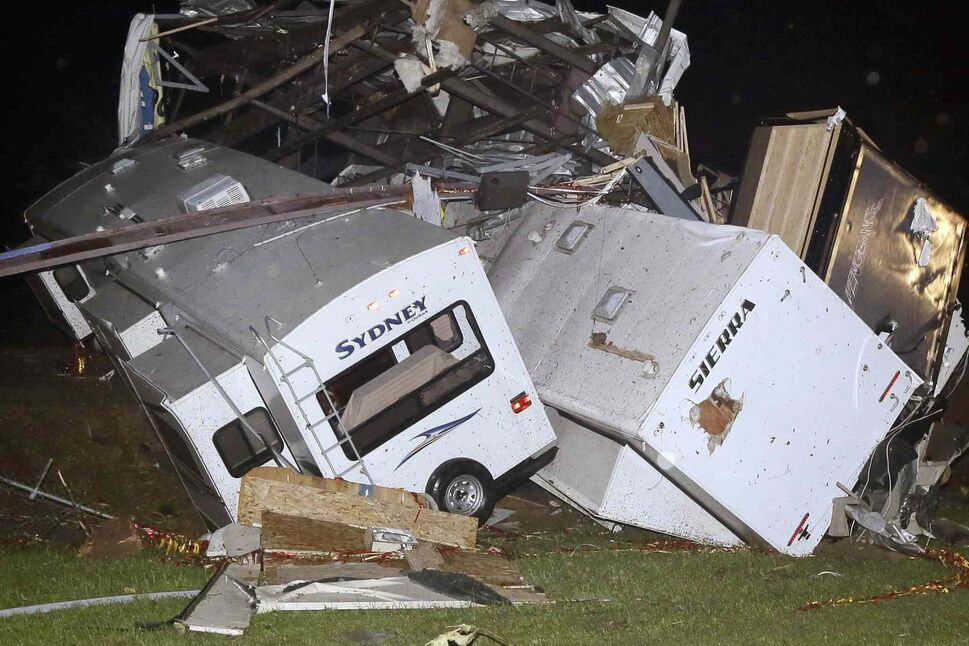 Travel trailers and motor homes are piled on top of each other at Mayflower RV in Mayflower, Ark., Sunday, after a powerful storm system rumbled through the central and southern United States on Sunday, spawning tornadoes.  (DANNY JOHNSTON / THE ASSOCIATED PRESS)